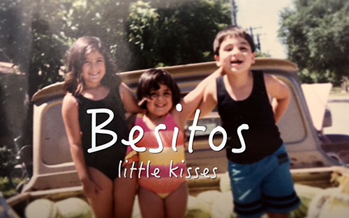 three children in swimming suits looking at the camera, superimposed words Besitos Small Kisses