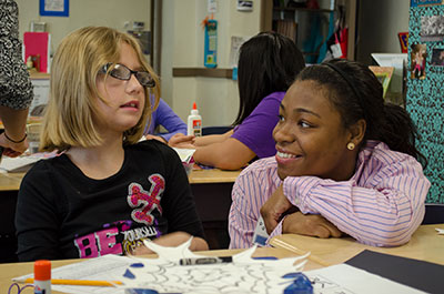 College of Education student LaCrisha Woods with a student